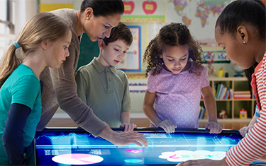 Children using large digital touchscreen display